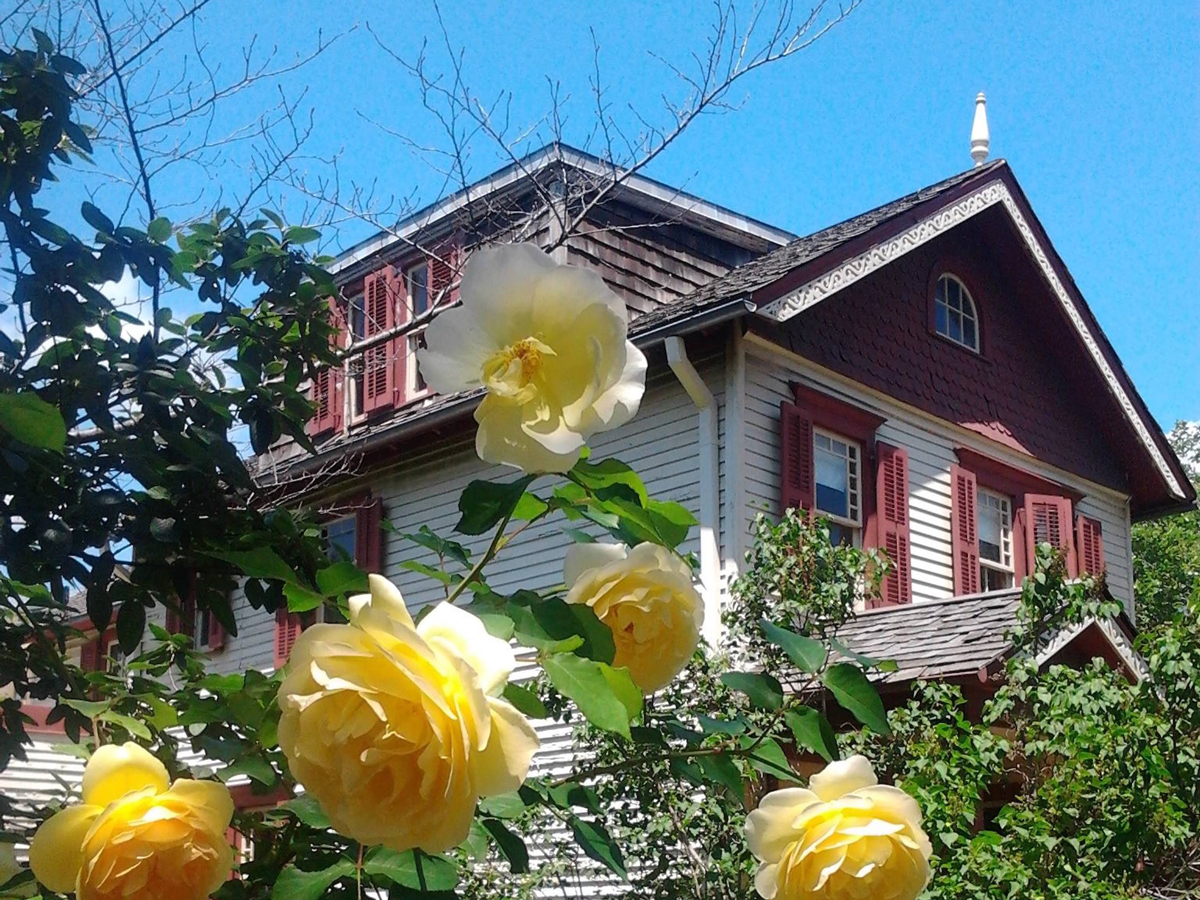 flowers in front of a historic townhouse museum