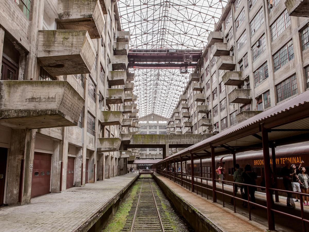 Industrial style courtyard with rails and balconies