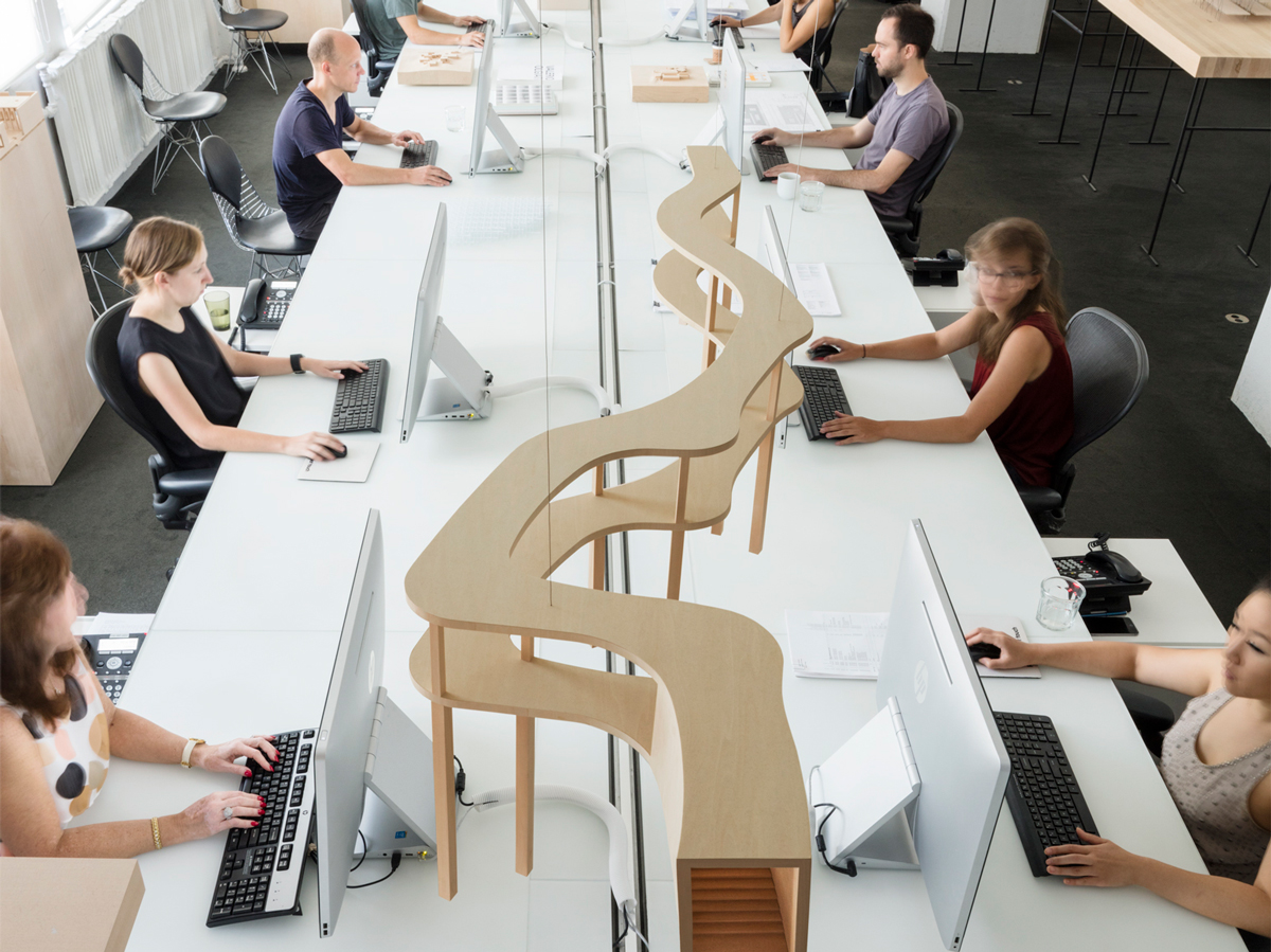 architects looking at a model on a desk