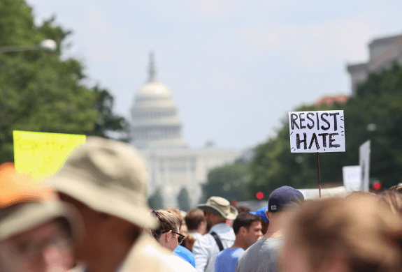 sign that says resist hate in a march in DC