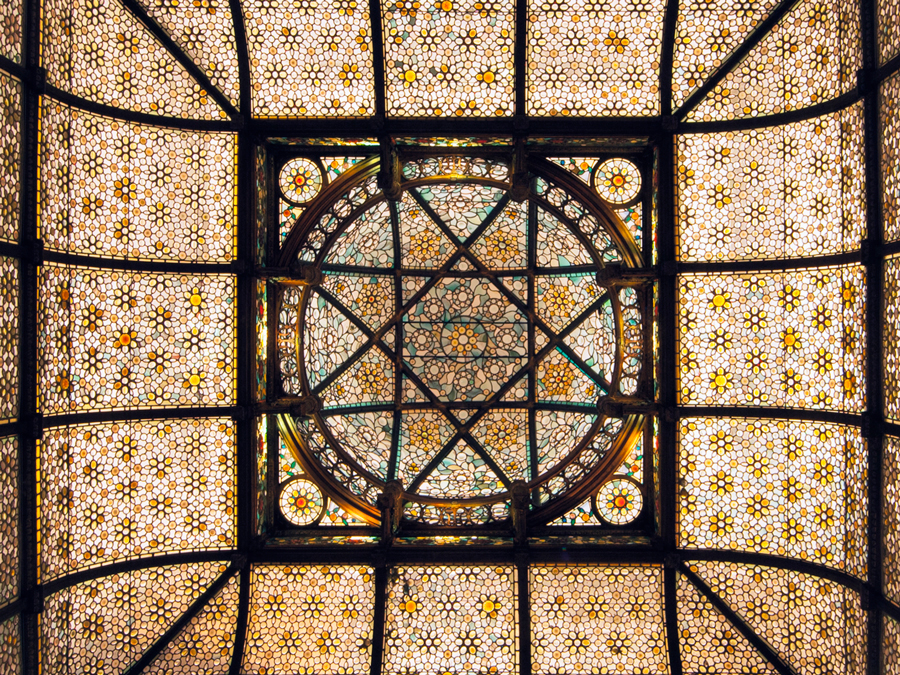 A stained glass ceiling with geometric patterns.