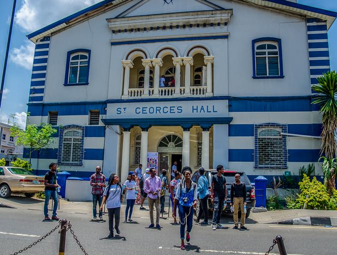 Visitors in Lagos exit a historic building