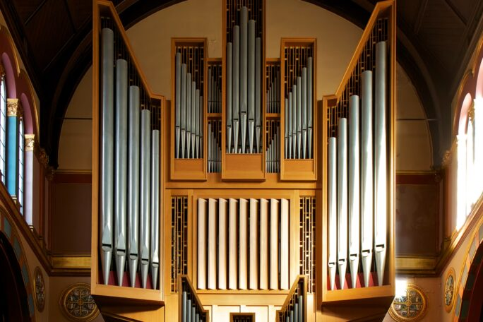Silver organ pipes ranked in geometric wooden cases