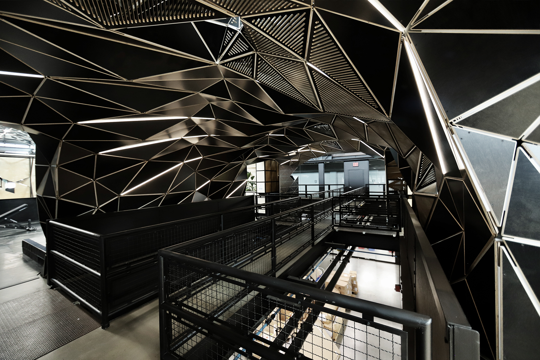 Metal geometric archway over an elevated walkway within the Crye offices.