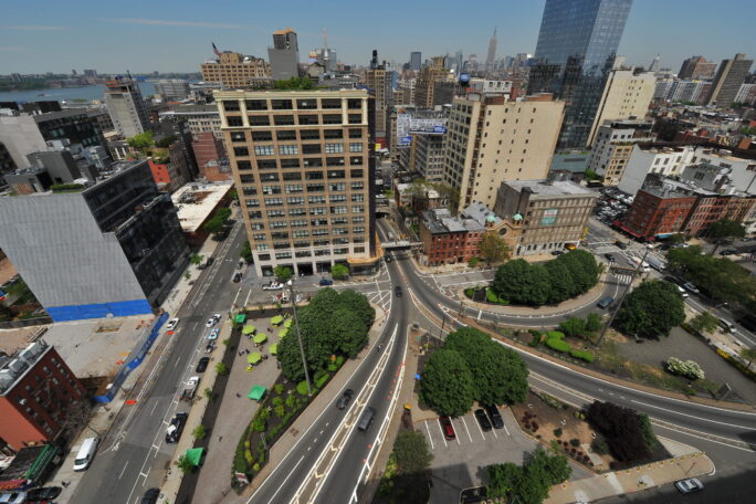 An aerial view of a streetscape with lanes converging on the entrance to the tunnel.