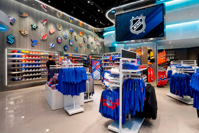 Interior of the NHL store with racks of hockey jerseys and hats