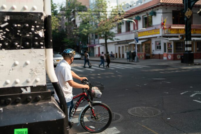 Image of a person at a bike at an intersection