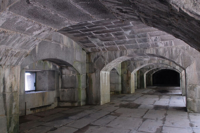 Stone arched cannon sights in the Water Battery at Fort Totten