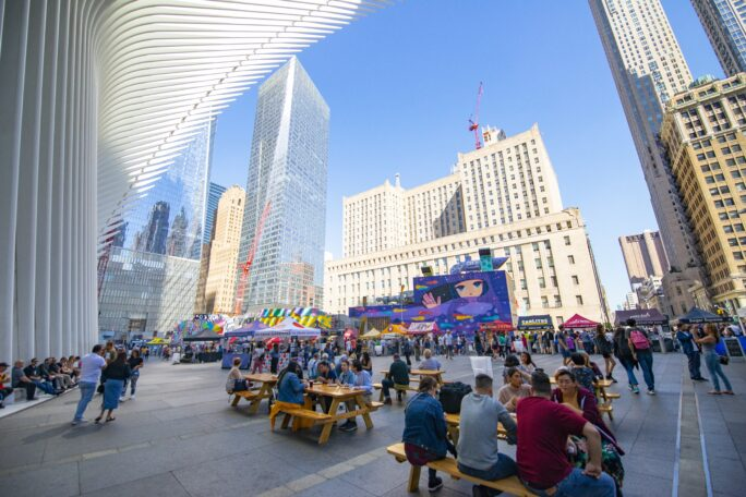A large plaza beneath the Oculus outdoors with food tents