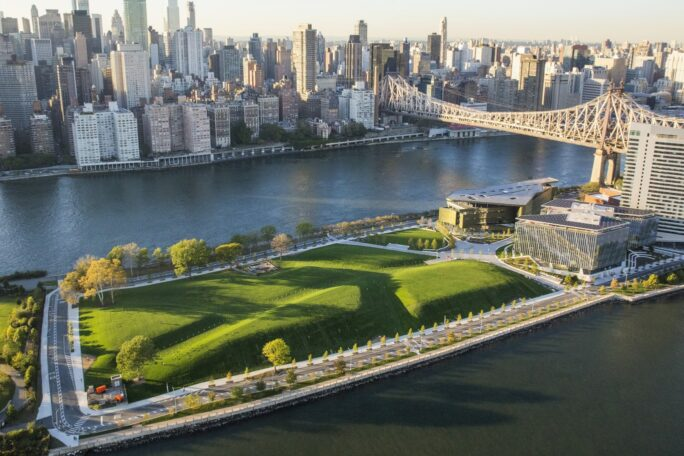 An aerial photo showing a large green lawn and office buildings on Roosevelt Island